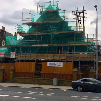 Scaffolding and hoardings on Woolwich New Road frontage, July 2017