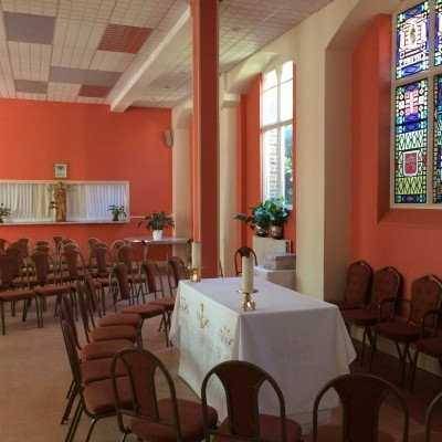 The lower hall of the Parish Centre arranged for weekday Masses - windows decorated by Fr Graziano